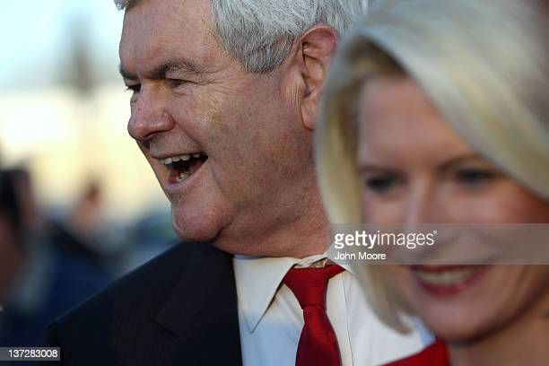 Republican presidential candidate former Speaker of the House Newt Gingrich and his wife Callista Gingrich greet supporters after arriving for a town...