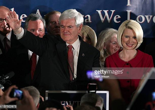 Republican presidential candidate former Speaker of the House Newt Gingrich and his wife Callista Gingrich celebrate as they arrive for a primary...