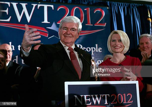 Republican presidential candidate former Speaker of the House Newt Gingrich speaks during a primary night rally with his wife Callista Gingrich...