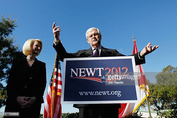 Republican presidential candidate former Speaker of the House Newt Gingrich stands with his wife Callista Gingrich as he speaks during a Lakeside Inn...