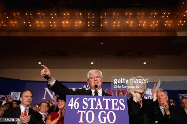 Republican presidential candidate former Speaker of the House Newt Gingrich speaks as his wife Callista looks on during his Florida primary night...