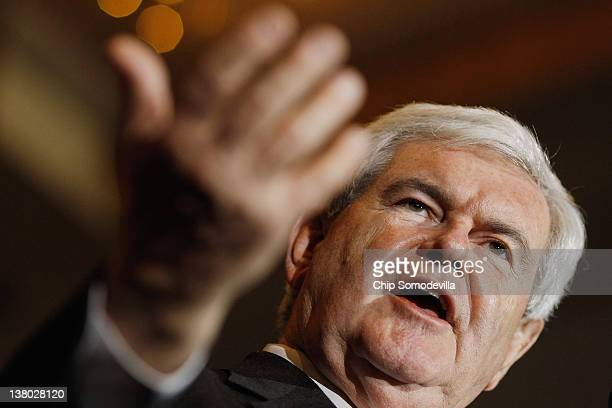 Republican presidential candidate former Speaker of the House Newt Gingrich speaks during his Florida primary night party January 31 2012 in Orlando...