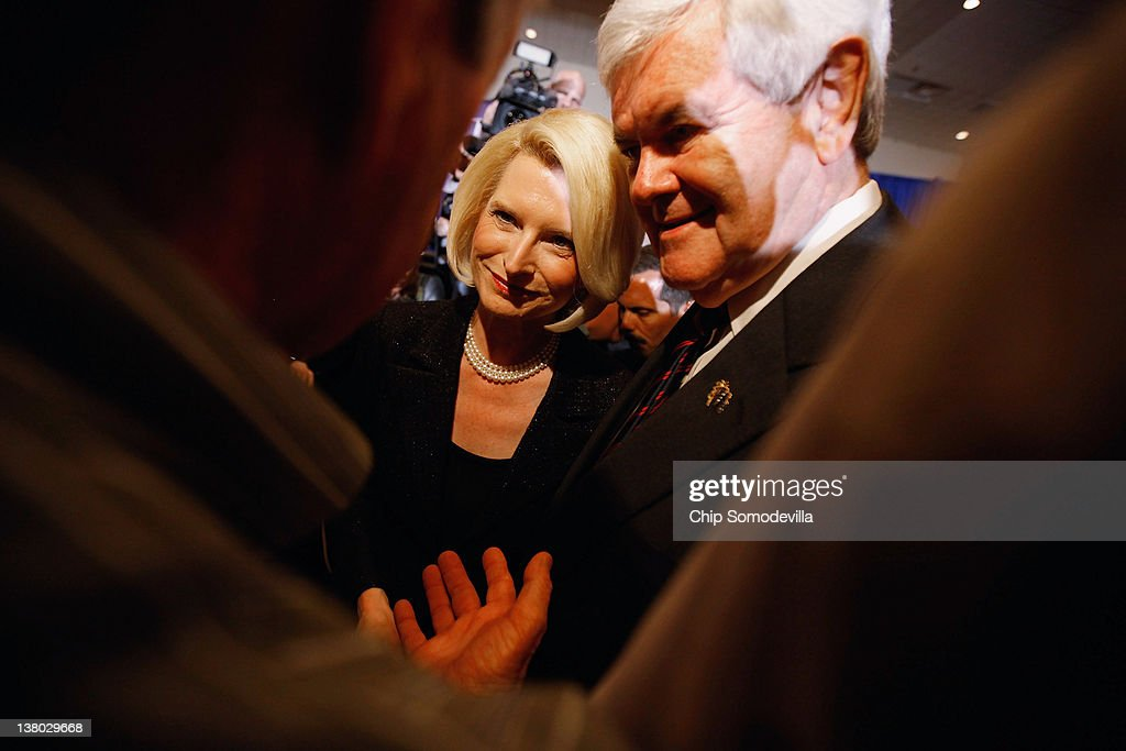 Republican presidential candidate, former Speaker of the House Newt Gingrich and his wife Callista Gingrich talk with supporters during his Florida primary night party January 31, 2012 in Orlando, Florida. According to early results former Massachusetts Gov. Mitt Romney defeated Gingrich, former U.S. Sen. Rick Santorum and U.S. Rep. Ron Paul (R-TX) to win Florida's primary.