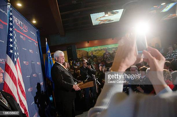 Republican presidential candidate former Speaker of the House Newt Gingrich addresses supporters inside Great Basin Brewing Company on February 1...