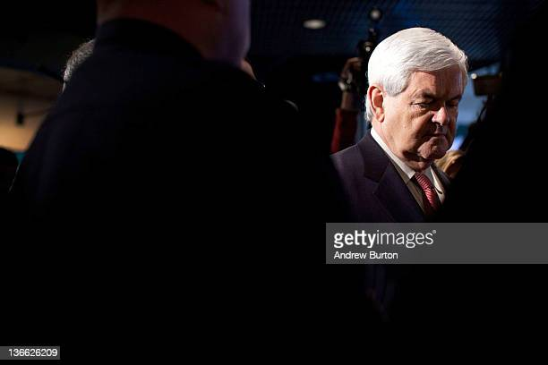 Republican presidential candidate former Speaker of the House of Representatives Newt Gingrich waits to be introduced on stage before a town hall...