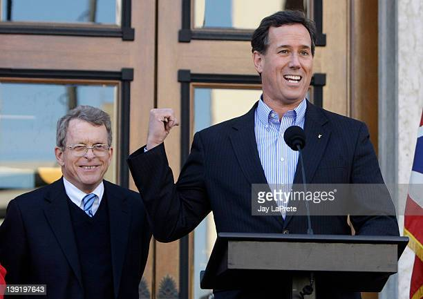 Republican presidential candidate former US Sen Rick Santorum speaks at a news conference as Ohio Attorney General Mike Dewine looks on February 17...