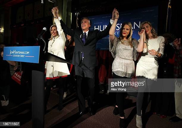 Republican presidential candidate, former Utah Gov. Jon Huntsman hold hands with his wife Mary Kaye , daughters Liddy , and Mary Anne as they...