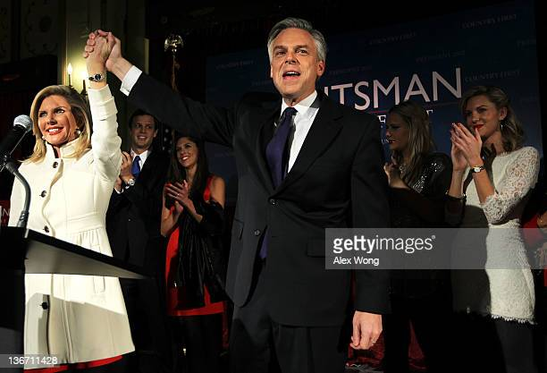 Republican presidential candidate, former Utah Gov. Jon Huntsman holds his wife Mary Kaye's hand as son-in-law Jeffrey Livingston , daughters Abby ,...