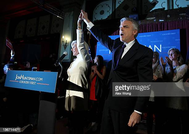 Republican presidential candidate former Utah Gov Jon Huntsman holds hands with his wife Mary Kaye as they celebrate during a primary night rally at...