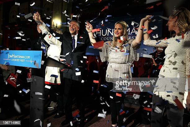 Republican presidential candidate, former Utah Gov. Jon Huntsman holds hands with his daughters Liddy , and Mary Anne as they celebrate during a...
