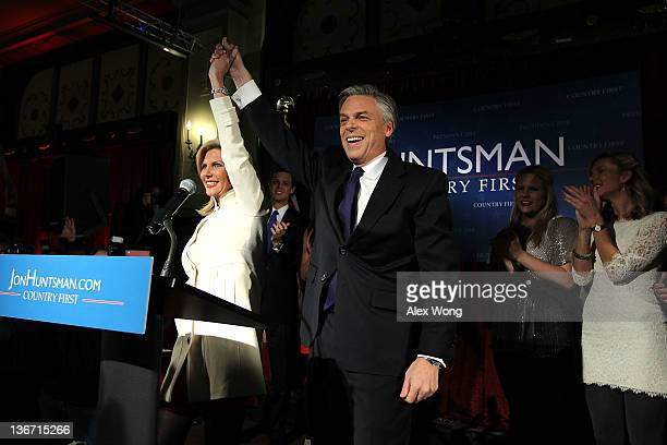 Republican presidential candidate former Utah Gov Jon Huntsman holds hands with his wife Mary Kaye as soninlaw Jeffrey Livingston daughters Liddy and...
