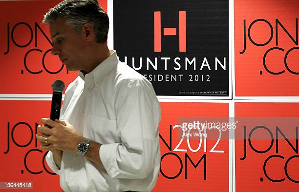 Republican presidential candidate former Utah Gov Jon Huntsman pauses as he speaks to employees during a campaign stop at Goss International January...