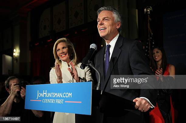 Republican presidential candidate former Utah Gov Jon Huntsman smiles as his wife Mary Kaye and daughter Abby Livingston look on during a primary...