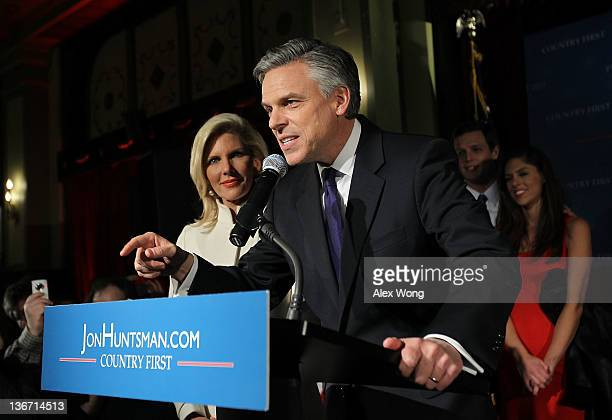 Republican presidential candidate former Utah Gov Jon Huntsman speaks to supporters as his wife Mary Kaye daughter Abby Livingston and soninlaw...