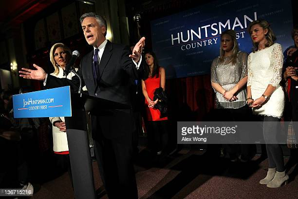 Republican presidential candidate, former Utah Gov. Jon Huntsman speaks as his wife Mary Kaye , daughters Abby , Liddy , and Mary Anne listen during...