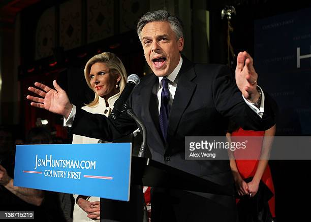 Republican presidential candidate former Utah Gov Jon Huntsman speaks to supporters as his wife Mary Kaye looks on during a primary night rally at...