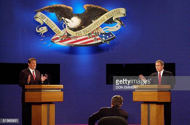 Republican presidential candidate George W Bush and Democratic presidential candidate Al Gore debate 03 October at the University of...