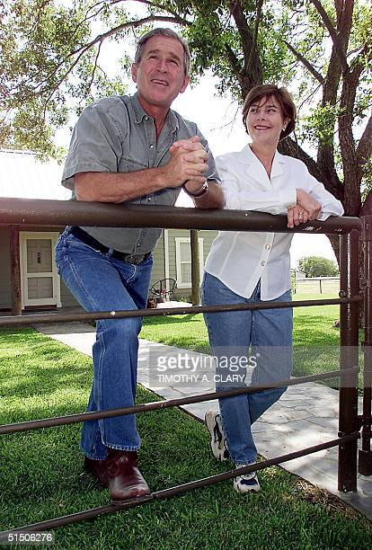Republican presidential candidate George W Bush and his wife Laura Bush give a tour of their ranch to the media 21 July 2000 in Crawford Texas Bush...