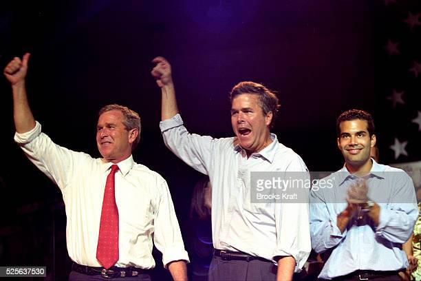 Republican Presidential candidate George W Bush attends a rally in Tampa with his brother Florida Governor Jeb Bush and nephew George P Bush