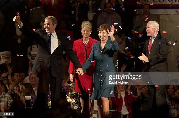 Republican presidential candidate George W Bush left and his wife Laura hold hands during a campaign rally October 30 2000 in Burbank CA as Sen John...