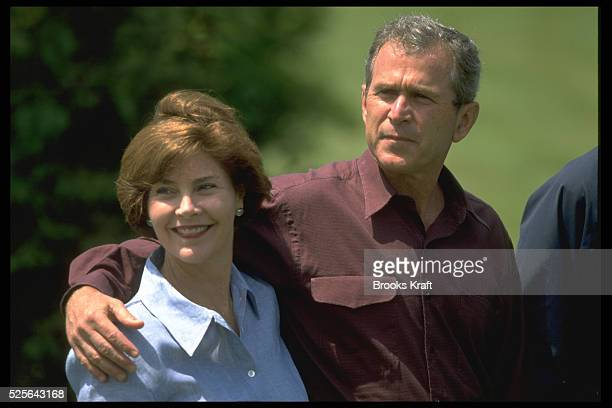 Republican presidential candidate George W Bush puts his arm around his wife Laura The couple were campaigning in New Hampshire for the 2000...