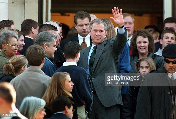 Republican presidential candidate George W Bush waves to parishioners after attending Sunday church service at the Tarrytown United Methodist Church...