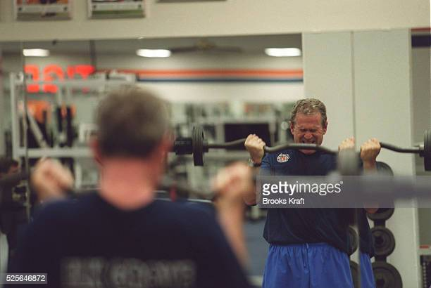 Republican presidential candidate George W Bush works out in a gym at Clemson University Texas Governor Bush took a break from campaigning for the...