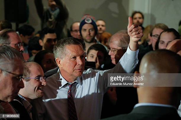 Republican presidential candidate Governor John Kasich gives a tumb up to guests at the end of his a rally on April 7 2016 in New York City Kasich...