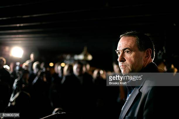 Republican presidential candidate Governor Mike Huckabee speaks to the press while campaigning in Indianola