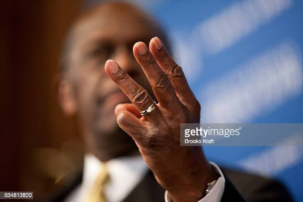 Republican presidential candidate Herman Cain speaks at the National Press Club in Washington. Cain has denied accusations made in a report of sexual...