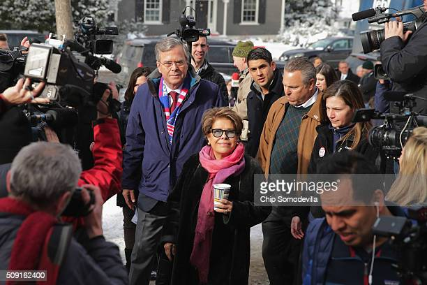 Republican presidential candidate Jeb Bush and his wife Columba Bush greet and thank supporters outside the polling place at Webster School on...