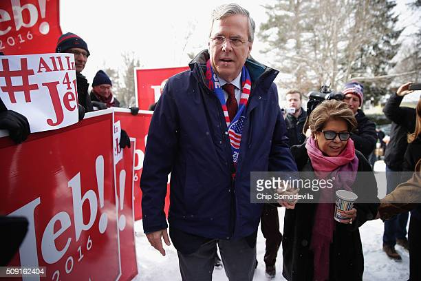 Republican presidential candidate Jeb Bush and his wife Columba Bush thank supporters outside the polling place at Webster School on primary day...