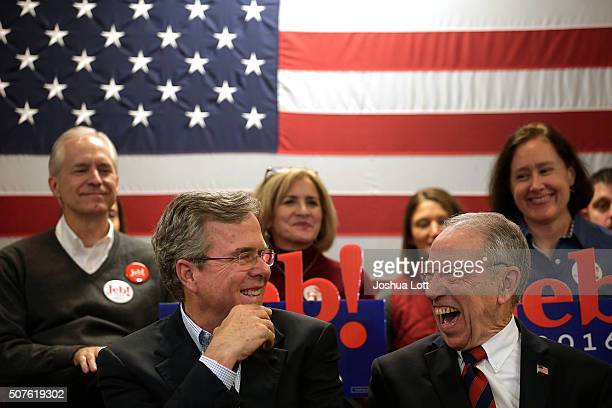 Republican presidential candidate Jeb Bush and US Senator Chuck Grassley share a laugh together during a campaign event for Bush at the Cedar Falls...