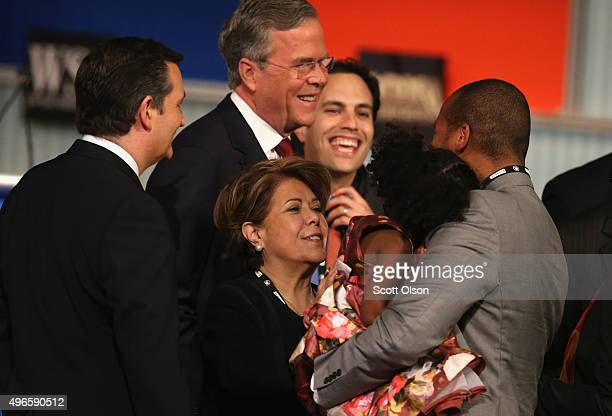 Republican presidential candidate Jeb Bush and wife Columba Bush greet people on stage after the Republican Presidential Debate sponsored by Fox...