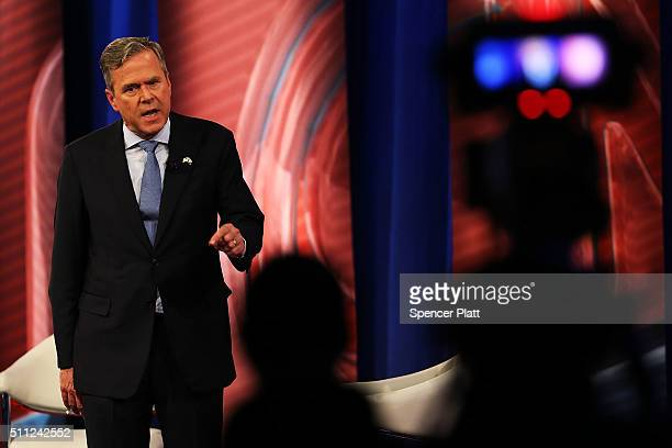 Republican presidential candidate Jeb Bush answers an audience members question in a CNN South Carolina Republican Presidential Town Hall with host...