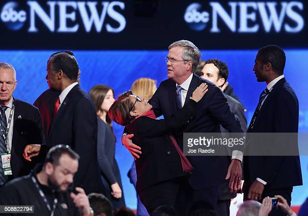 Republican presidential candidate Jeb Bush embraces his wife Columba at the conclusion of the Republican presidential debate at St Anselm College...