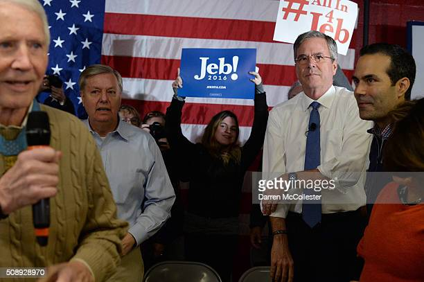 Republican Presidential candidate Jeb Bush prepares to speak at a town hall at Woodbury School with son George February 7 2016 in Salem New Hampshire...