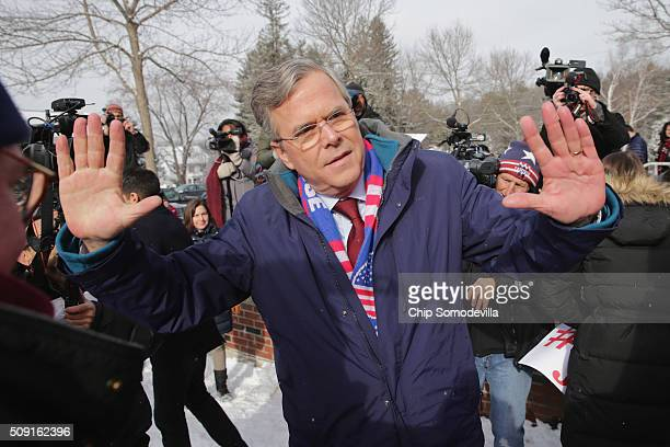 Republican presidential candidate Jeb Bush thanks his supporters outside the polling place at Webster School on primary day February 9 2016 in...