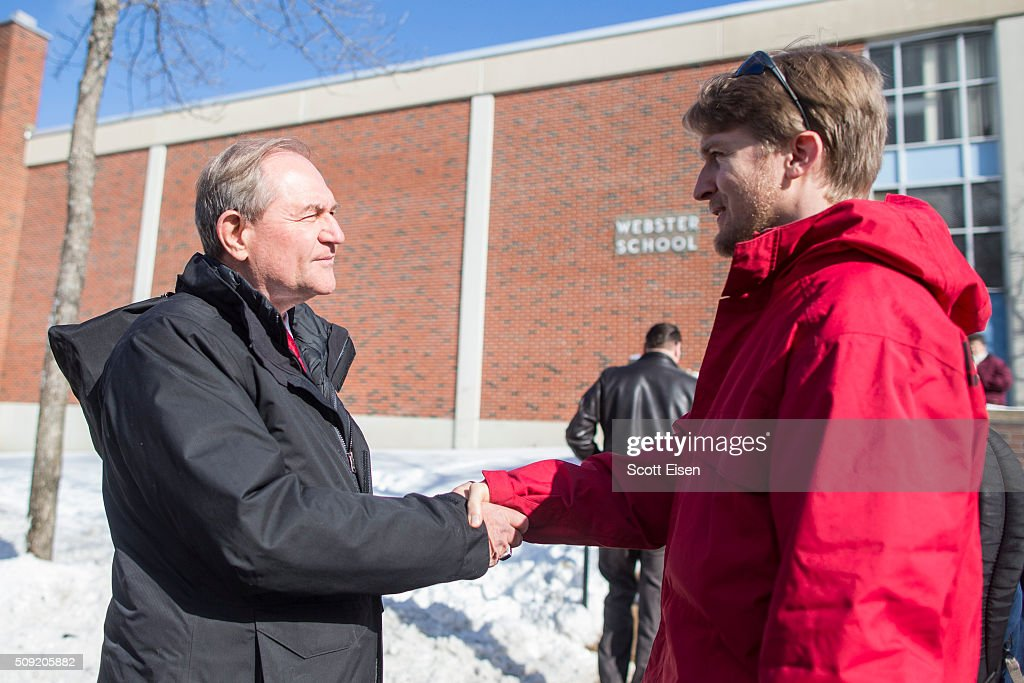Republican presidential candidate Jim Gilmore greets voters outside the polling place at Webster School on primary day February 9, 2016 in Manchester, New Hampshire. Candidates from both parties are making last-minute attempts to swing voters to their side on the day of the 'First in the Nation' presidential primary.
