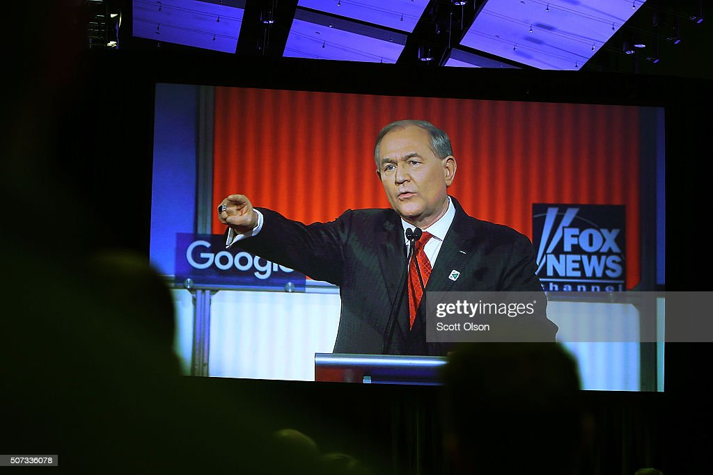 Republican presidential candidate Jim Gilmore is seen on a TV screen as he participates in the Fox News - Google GOP Debate January 28, 2016 at the Iowa Events Center in Des Moines, Iowa. Residents of Iowa will vote for the Republican nominee at the caucuses on February 1.