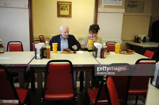 Republican presidential candidate John McCain and his running mate Alaska Governor Sarah Palin have a meal at Arthur Bryant's Barbeque restaurant in...