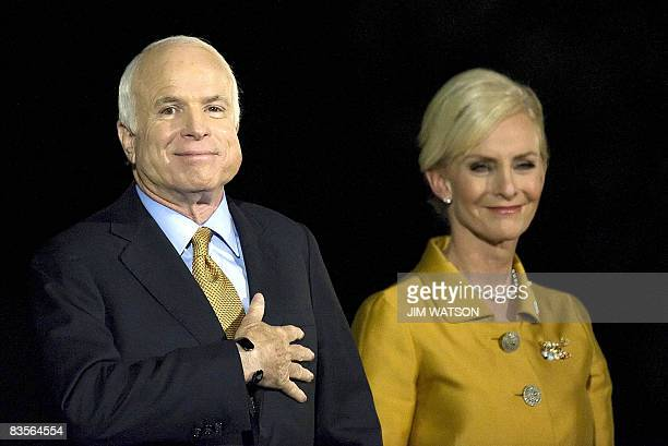 Republican presidential candidate John McCain gestures on stage with wife Cindy after conceding the 2008 presidential election to Demoratic rival...