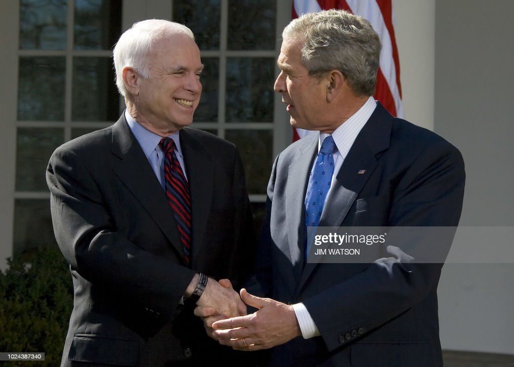 Republican presidential candidate John McCain (L) shakes hands with US President George W. Bush after recieving his endorsement in the Rose Garden of the White House in Washington, DC, March 05, 2008. President Bush on Wednesday anointed one-time bitter rival John McCain as his preferred successor and heir to the vastly unpopular Iraq war and deepening economic fears. AFP PHOTO/Jim WATSON