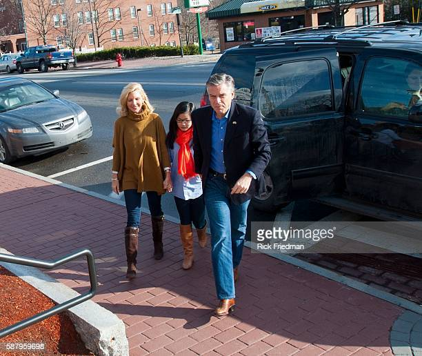Republican presidential candidate Jon Huntsman arriving at a campaign stop at the Derry Opera House in Derry NH on December 30 2011 with his wife...