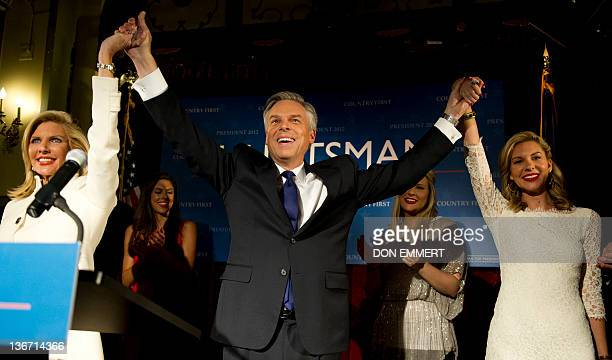 Republican presidential candidate Jon Huntsman celebrates his third place finish with his wife Mary Kaye and daughter Mary Anne at his election night...