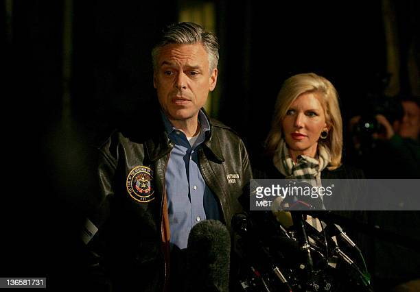 Republican presidential candidate Jon Huntsman with his wife Mary Kaye Huntsman speaks with the press before meeting with supporters in Bedford New...