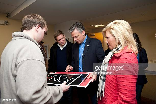 Republican presidential candidate Jon Huntsman with his wife Mary Kaye Huntsman signing autographs after speaking at a town hall meeting at Pelham NH...