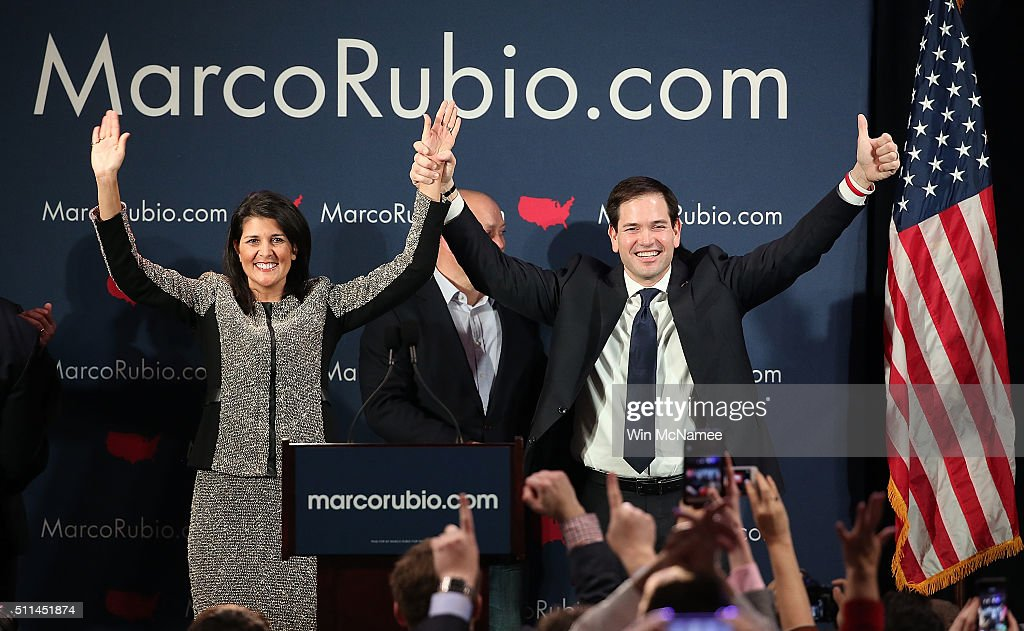 Republican presidential candidate Marco Rubio (R) and South Carolina Gov. Nikki Haley (L) celebrate after Rubio addressed ssupporters at a primary night event February 20, 2016 in Columbia, South Carolina. Rubio was locked in a tight race with Sen. Ted Cruz for second place in the 'First in the South' primary.