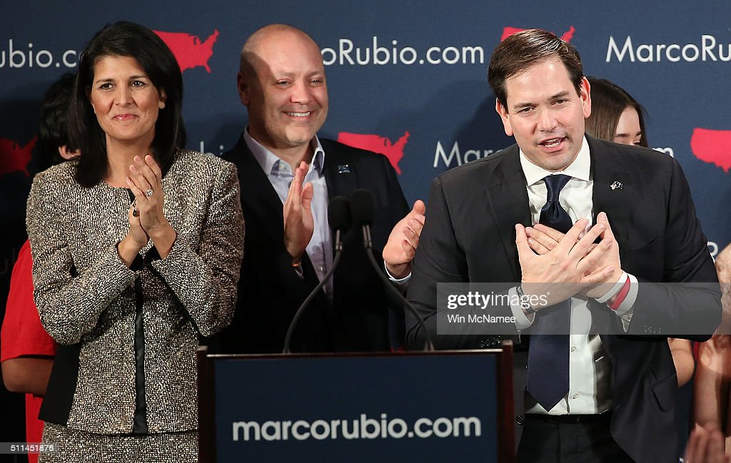 Republican presidential candidate Marco Rubio (R) and South Carolina Gov. Nikki Haley (L) celebrate after Rubio addressed supporters at a primary night event February 20, 2016 in Columbia, South Carolina. Rubio was locked in a tight race with Sen. Ted Cruz for second place in the 'First in the South' primary.