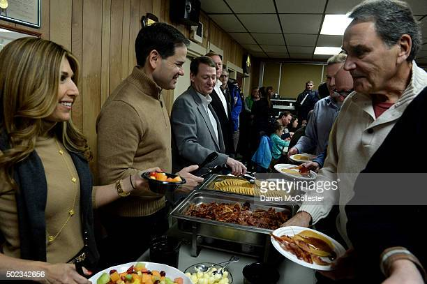 Republican Presidential candidate Marco Rubio and wife Jeanette hand out pancakes at a pancake breakfast at the Franklin VFW December 23 2015 in...
